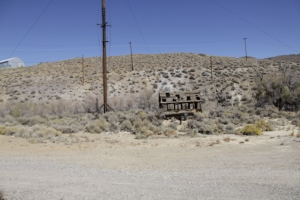 An abandoned building and Power lines near Virginia City, Nevada.
