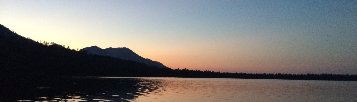 This was taken at sunset and there is sunlight behind the mountain located in the northwest side of the lake.