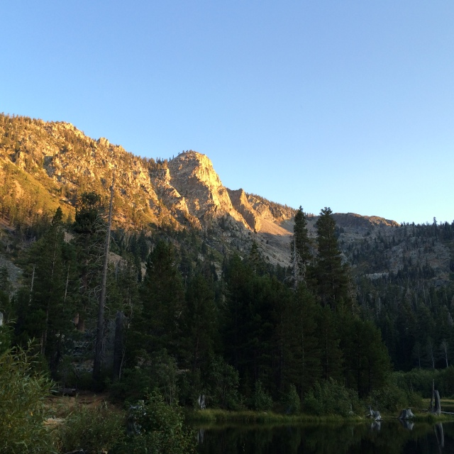 Here is the sun setting on a mountain peak that is near Lily Lake in the Sierra Nevada Mountains.
